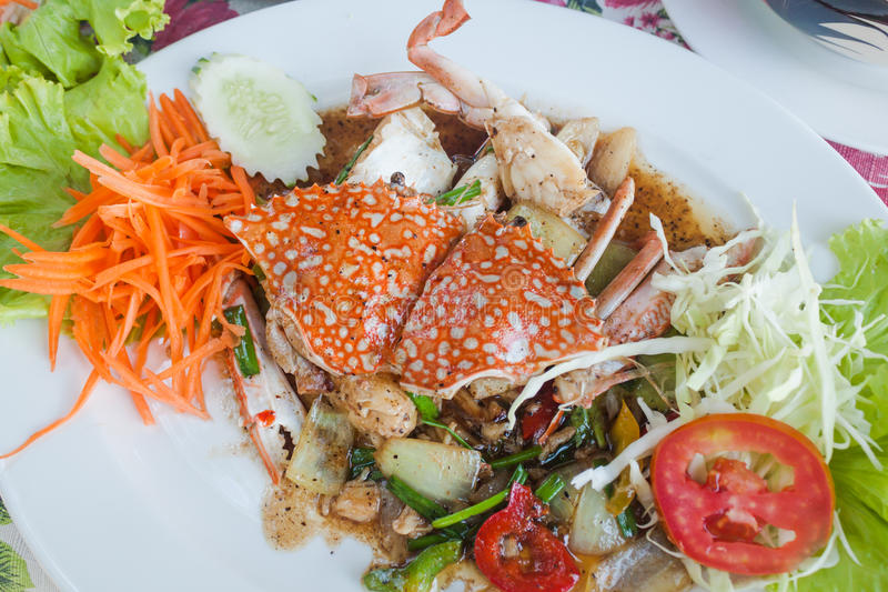 Stir fried sea crab with black pepper on white dish. Stir fried crab with black pepper on white dish, Sea food, Thai food royalty free stock images