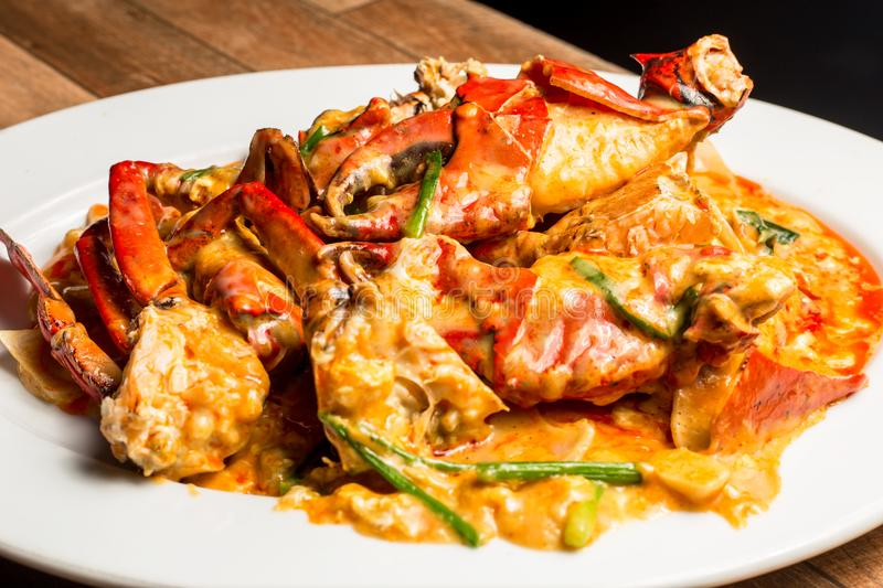 Stir-Fried Sea Crab with Curry Powder Sauce, Milk and Eggs. A popular Thai-Chinese seafood royalty free stock photo