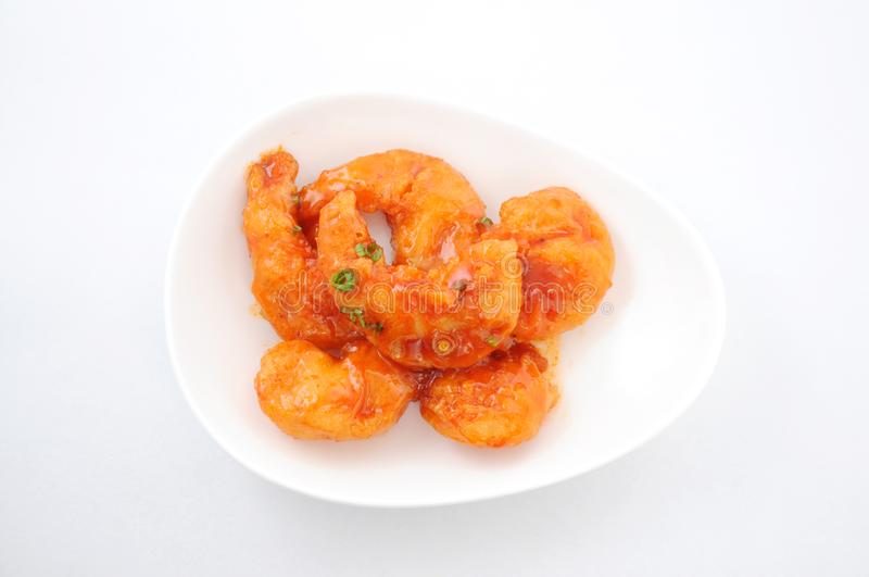 Stir-fried shrimp in chili sauce Chinese dish on plate on white background royalty free stock photos