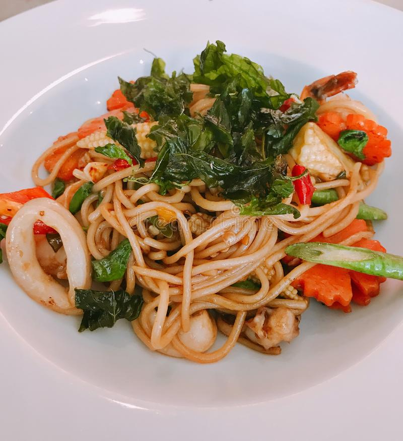 Spicy stir fried spaghetti. royalty free stock photography