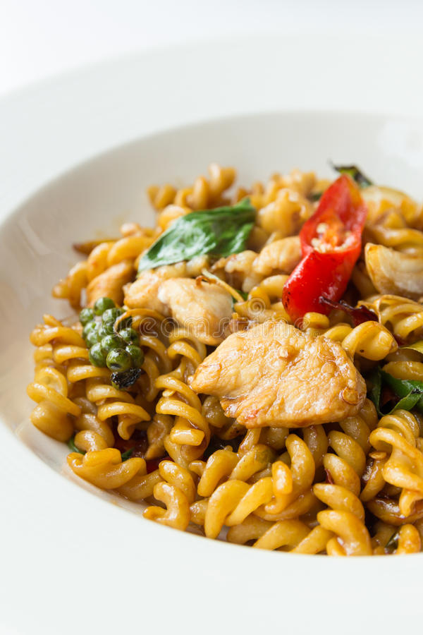Stir fried spicy fusilli with pork royalty free stock image
