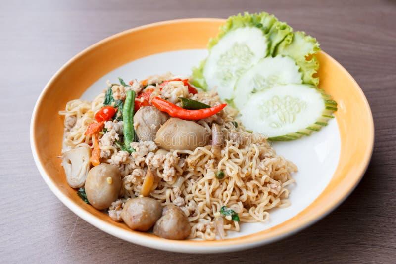 Stir fried spicy noodle with pork and straw mushroom stock photo