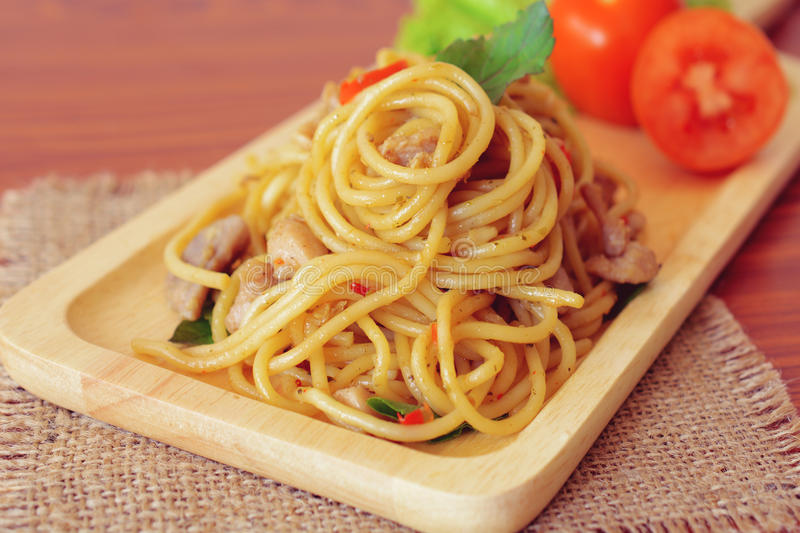 Stir-fried spicy spaghetti with chicken. Thai style. Stir-fried spicy spaghetti with chicken stock images