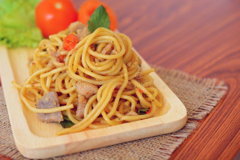 Stir-fried spicy spaghetti with chicken. Thai style. Stir-fried spicy spaghetti with chicken stock photo