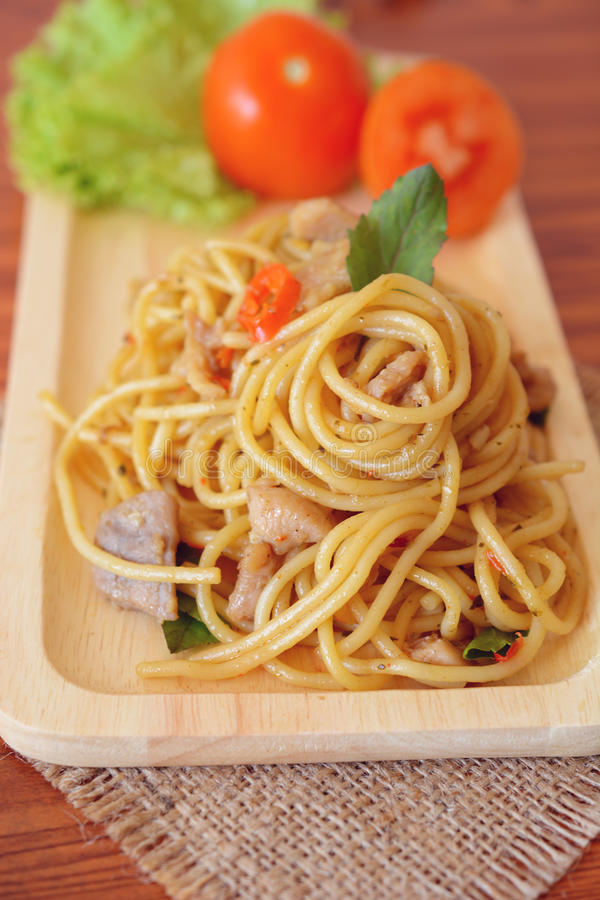 Stir-fried spicy spaghetti with chicken. Thai style stock photography