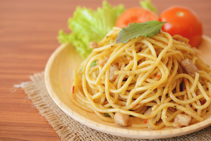 Stir-fried spicy spaghetti with chicken. Thai style royalty free stock images
