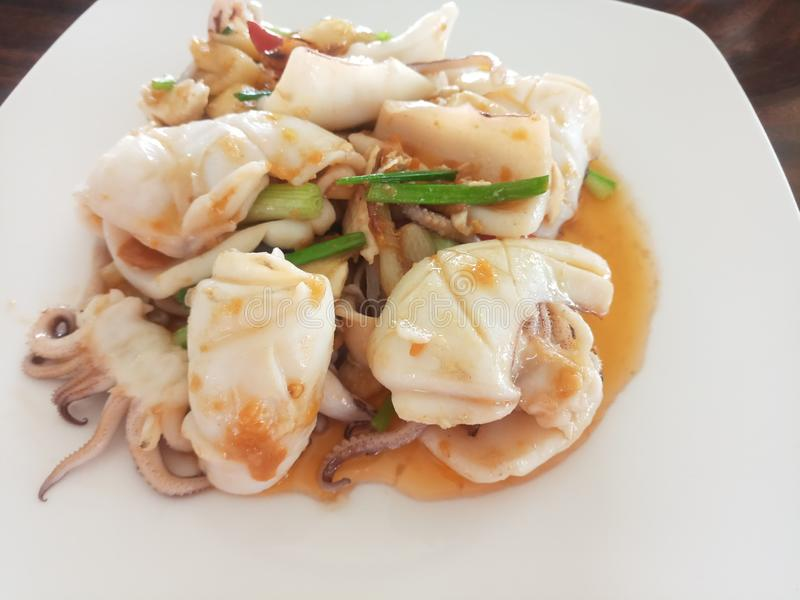 Stir fried squid with salty egg. Vegetable, shallot, seafood, delicious, thai, healthy royalty free stock photography