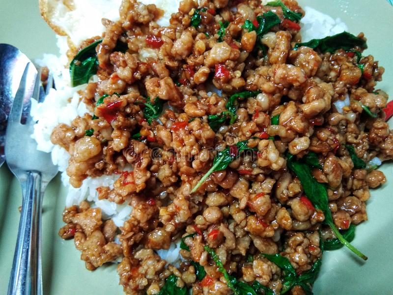 Stir fried Thai basil with minced pork and a fried egg, Over medium egg. Food, delicious, main, thailand, thaifood, madeinthai, ingredients, delivery, express stock images