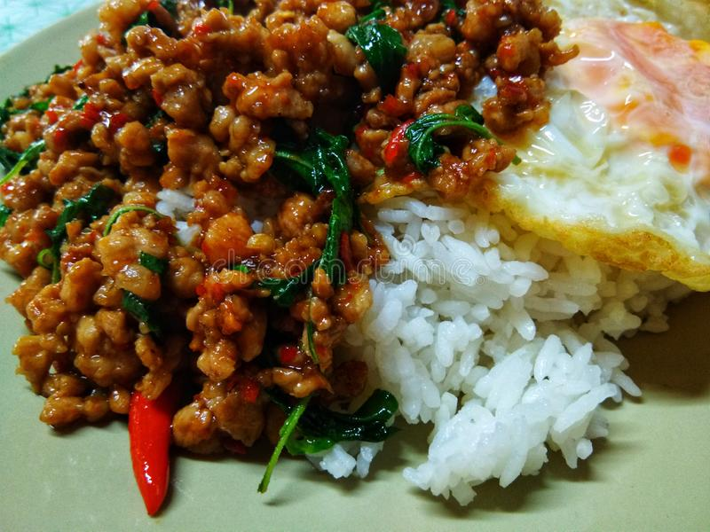 Stir fried Thai basil with minced pork and a fried egg, Over medium egg. Food, delicious, main, thailand, thaifood, madeinthai, ingredients, delivery, express royalty free stock images