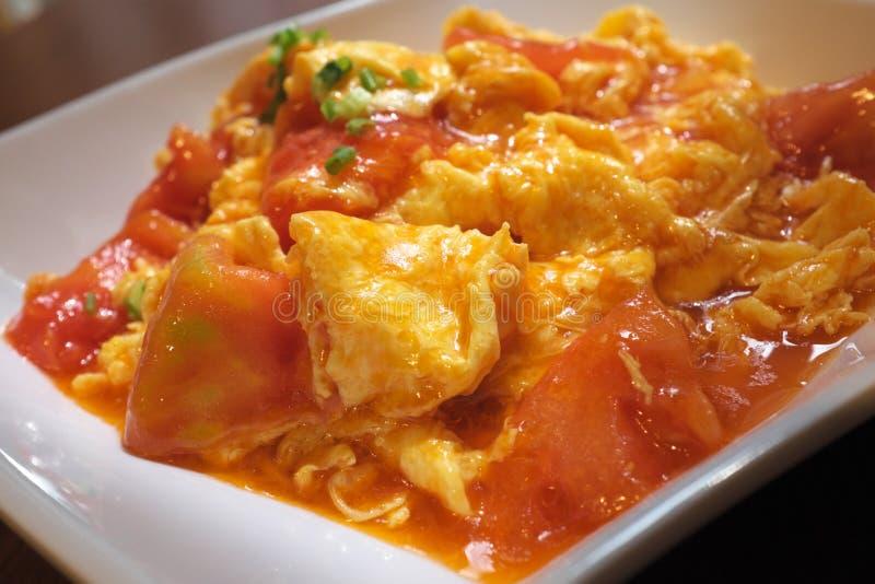 Stir fried tomato and egg. Closeup view of stir fried tomato and egg stock image