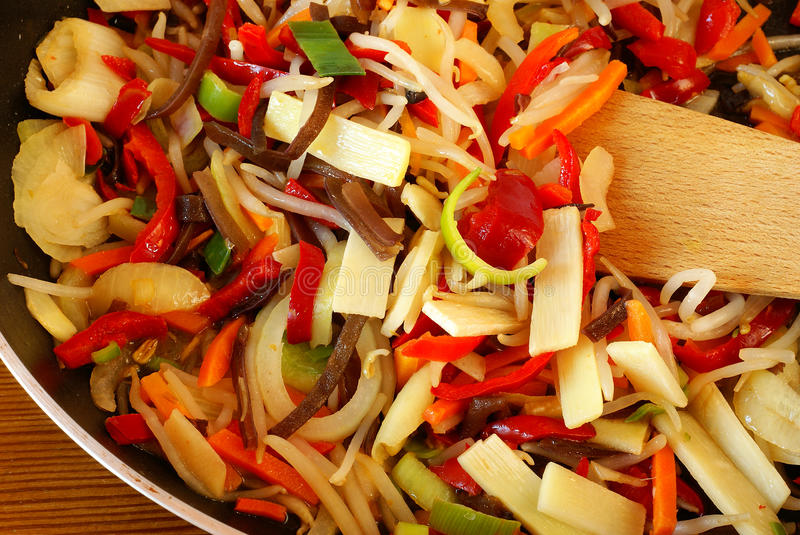 Stir-fried vegetables. Chinese mix of vegetables stir-fried on pan stock images