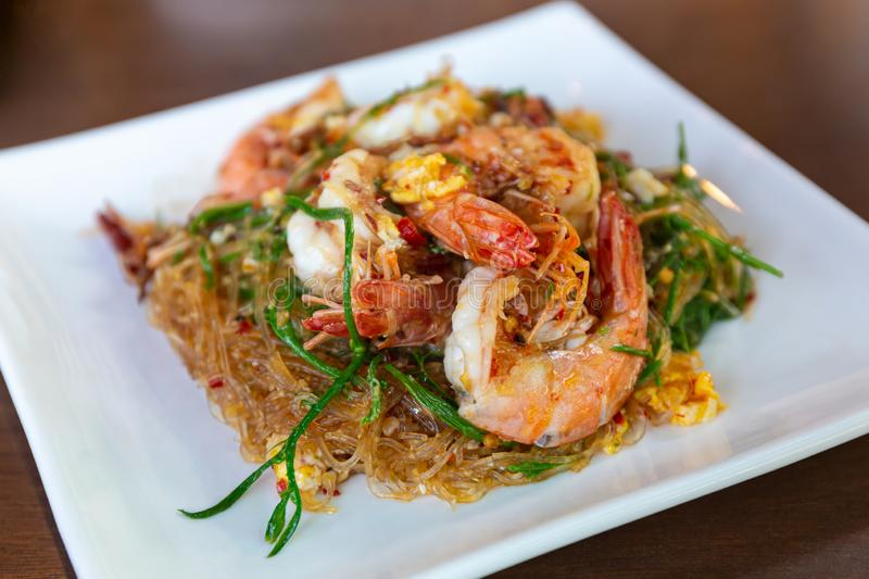 Stir-fried vermicelli with shrimp and climbing wattle vegetable stock image