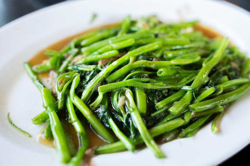 Stir Fried Water Spinach. Pak boong fai dang of Thai food royalty free stock photography