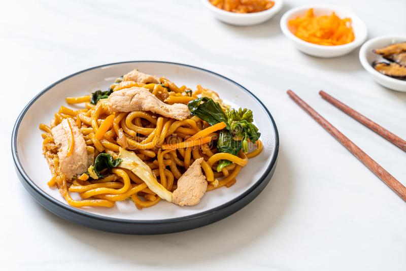 stir-fried yakisoba noodles with chicken stock photo