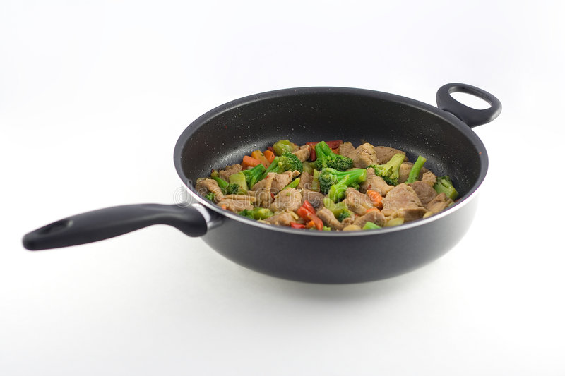 Stir fry. In a pan royalty free stock photo