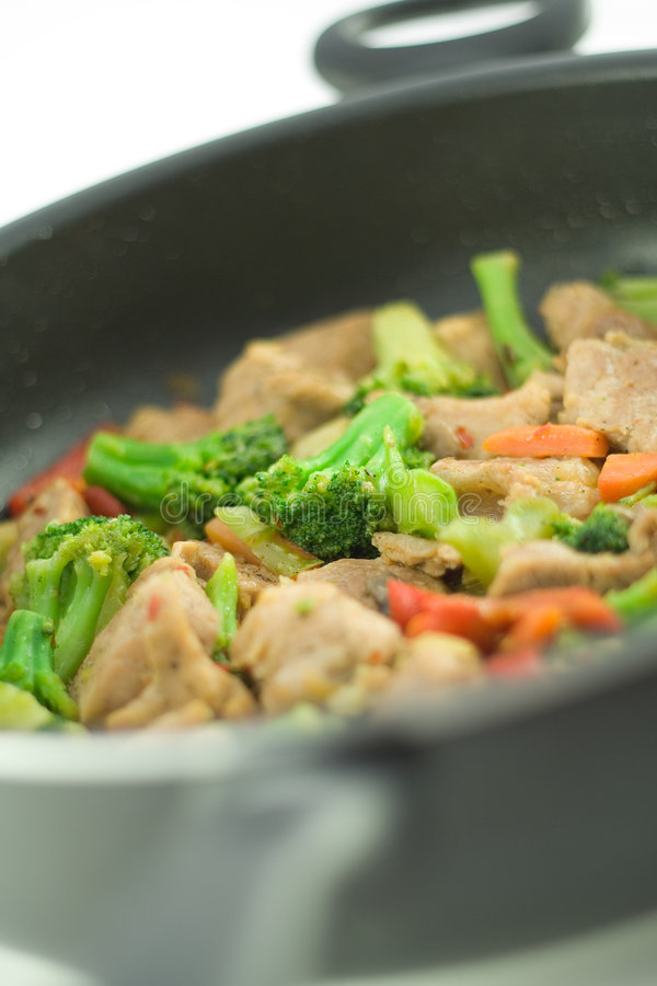 Stir fry. In a pan royalty free stock photos
