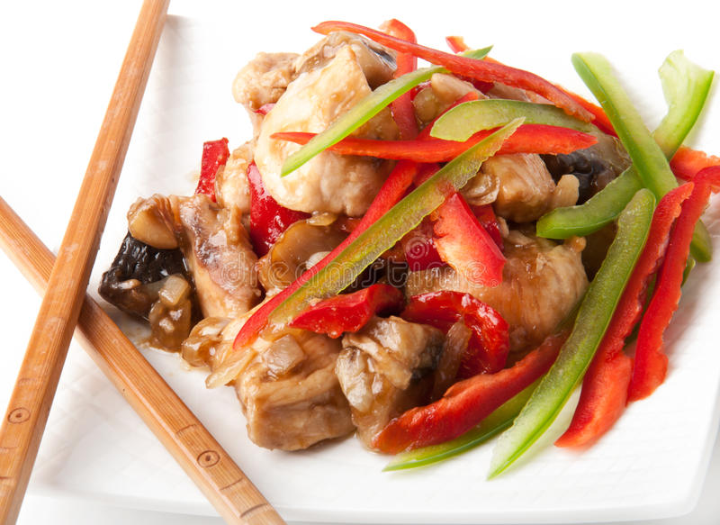 Stir fry chicken. With sweet peppers and mushrooms stock image