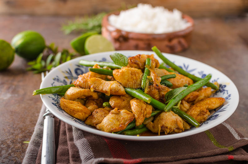Stir fry chicken. With beans and white rice royalty free stock images