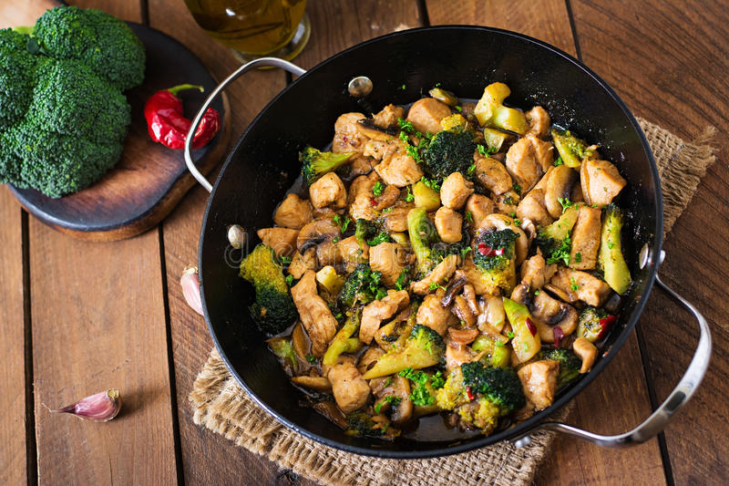 Stir fry chicken with broccoli and mushrooms. Stir fry chicken with broccoli and mushrooms - Chinese food stock images