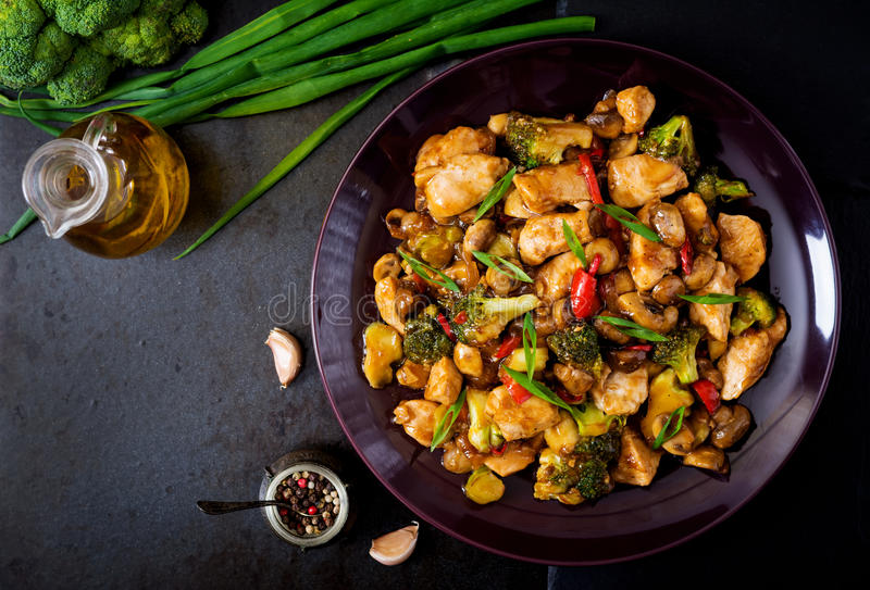 Stir fry with chicken, mushrooms, broccoli and peppers. Chinese food. Top view royalty free stock photo