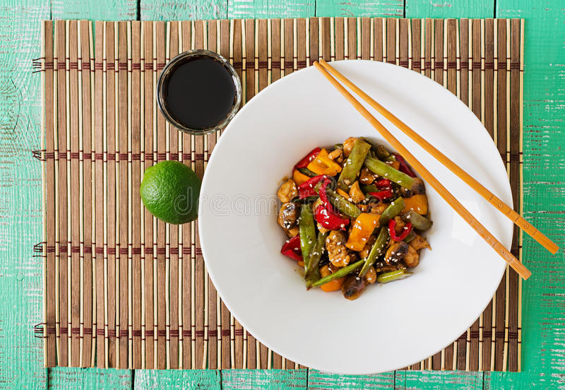 Stir fry with chicken, mushrooms, green beans and sweet peppers. Top view stock photo