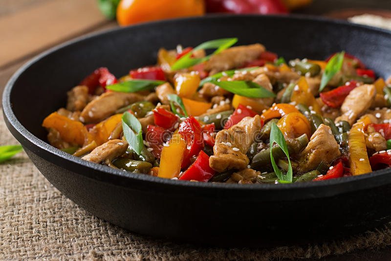 Stir fry chicken, peppers and green beans. Stir fry chicken, sweet peppers and green beans royalty free stock photo