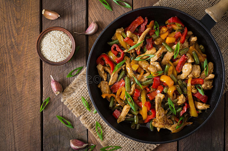Stir fry chicken, peppers and green beans. Top view. Stir fry chicken, sweet peppers and green beans. Top view stock photography