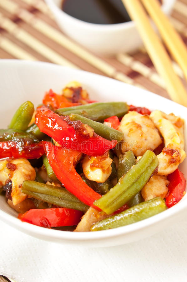 Stir fry chicken. With sweet peppers and green beans stock image