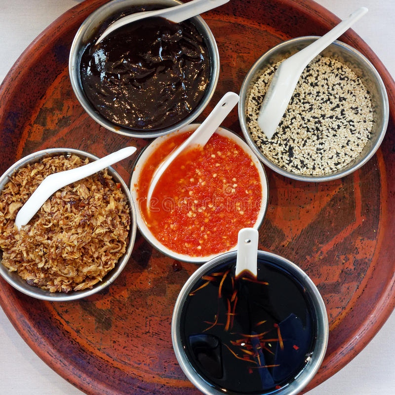 Stir Fry Condiments. Bowls of condiments, including red chilliy, ready for stir fry cooking in restaurant stock photos