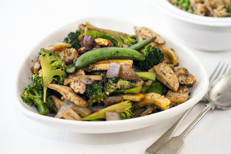 Stir fry dinner. With chicken and broccoli royalty free stock photos