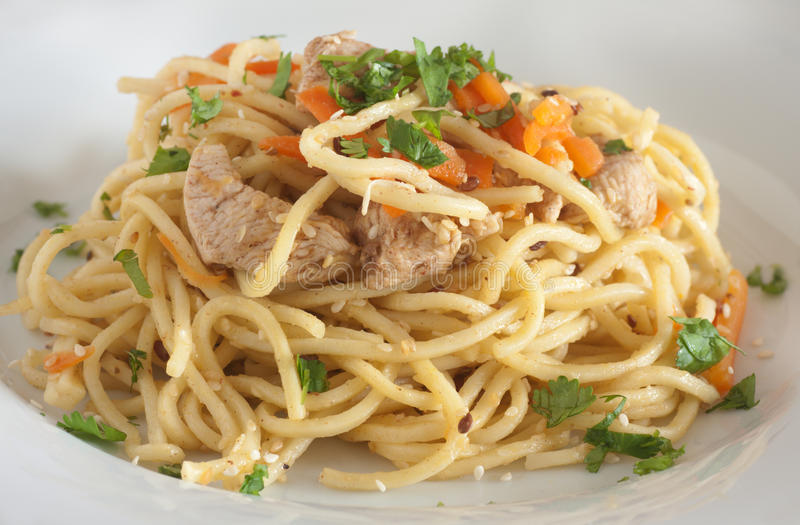 Stir fry noodle. With chicken stock photography