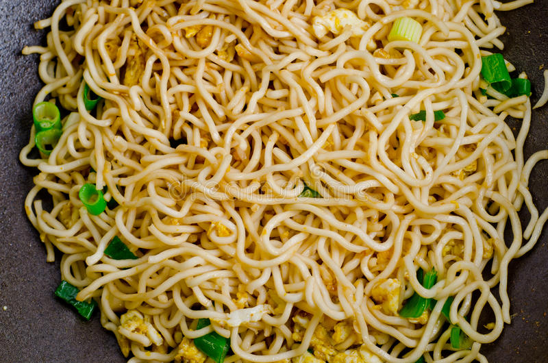 Stir-fry Noodles. Close up of stir-fry noodles in wok pan royalty free stock images