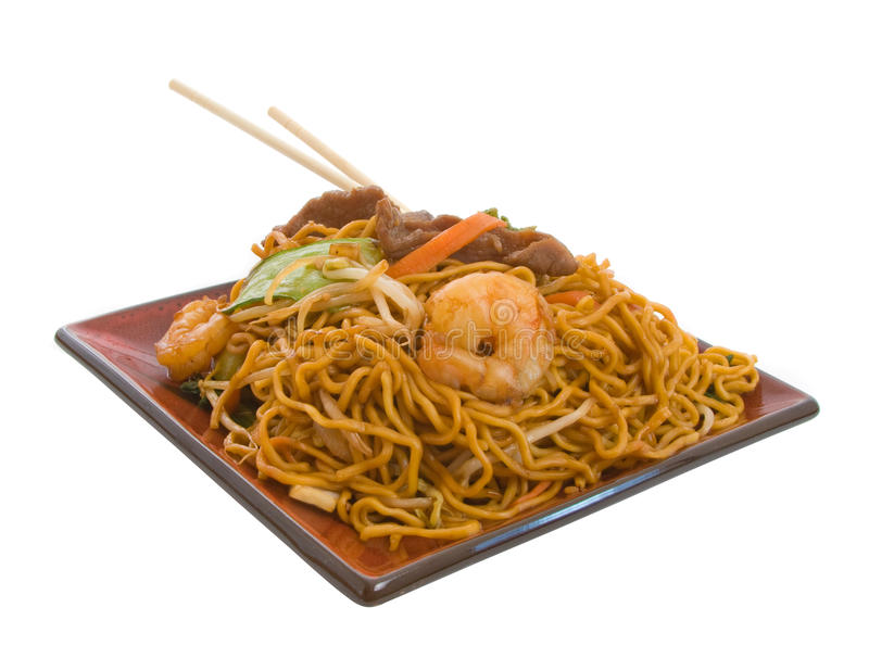 Stir Fry Noodles. Delicious Stir Fry Noodle combination isolated over white background royalty free stock images