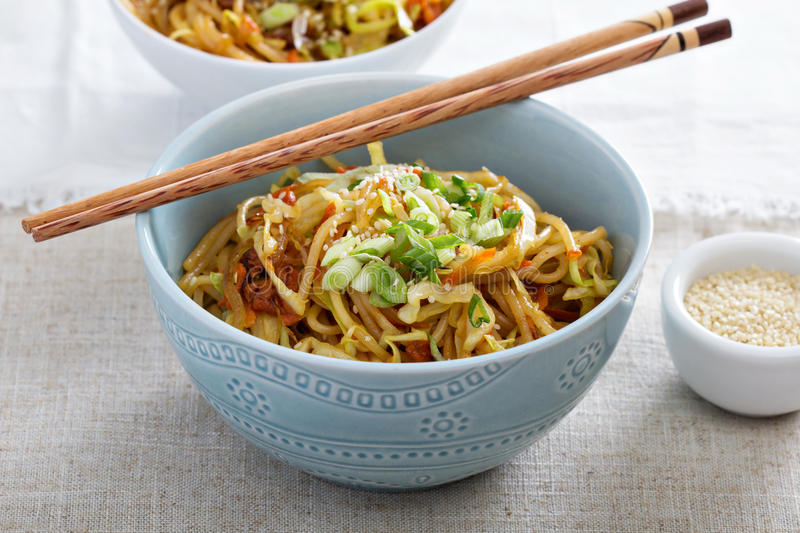 Stir fry with noodles, cabbage and carrot. Stir fry with rice noodles, cabbage and carrot royalty free stock image