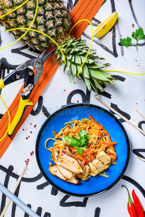 Stir fry noodles traditional Chinese wok, chopsticks, ingredients. Asian noodles stock images