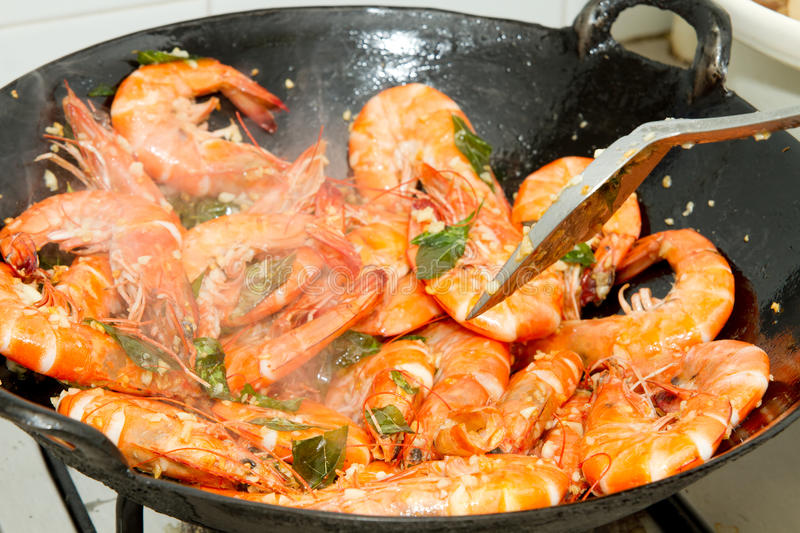Stir Fry Prawns with Curry Leaves and Garlic. In Wok royalty free stock image