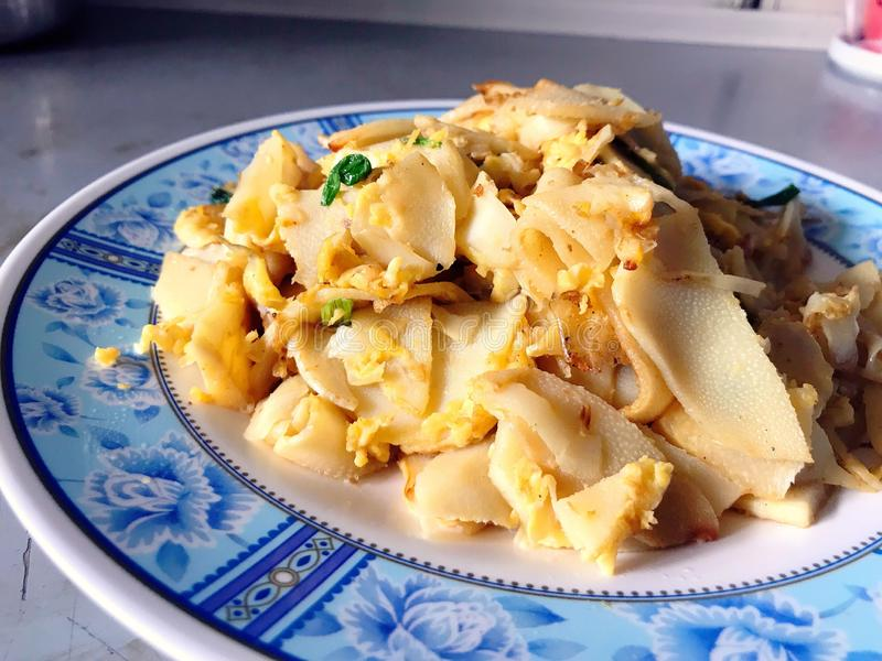 Stir fry preserved bamboo shoot with holy basil and meat ball royalty free stock photography