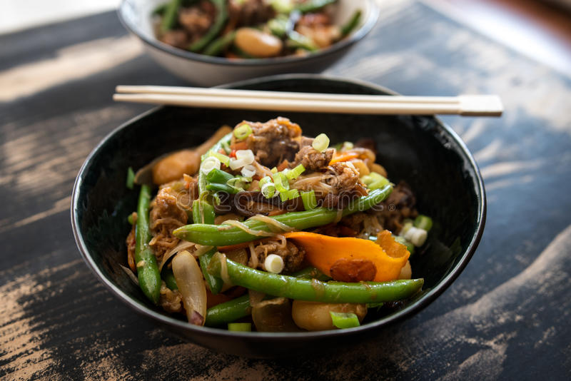 Stir fry with pulled oats, snap beans and carrots royalty free stock image