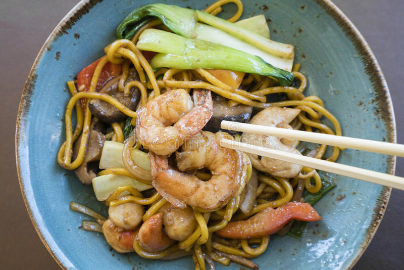 Stir fry seafood Hokkien noodle. Top down view of stir fry seafood Hokkien noodle stock photography