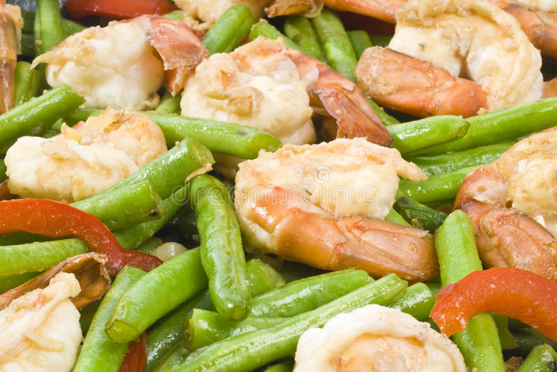 Stir Fry Shrimp with Vegetables. Close-up of colorful stir fry of shrimp, green beans and red bell pepper royalty free stock photography