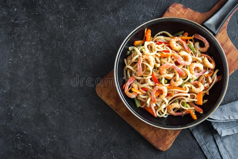 Stir fry with shrimps and noodles royalty free stock photography