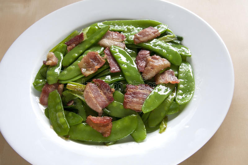 Stir-fry snow bean and bacon royalty free stock photo