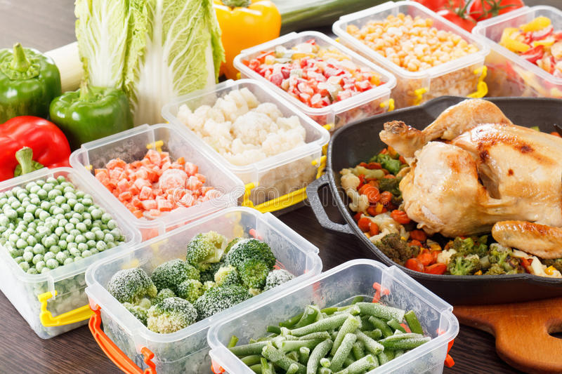 Stir fry vegetables frozen and roasted chicken food. Stir fry vegetables frozen in plastic container, roasted chicken and veggies. Healthy freezer food in tray royalty free stock images