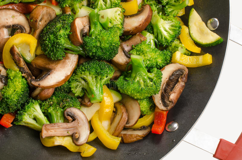 Wok stir-fry with vegetables. Stir-fry with vegetables in wok stock image