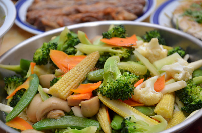 Stir-fry in a wok. Stir-fry of various type of vegetable in a wok royalty free stock photos