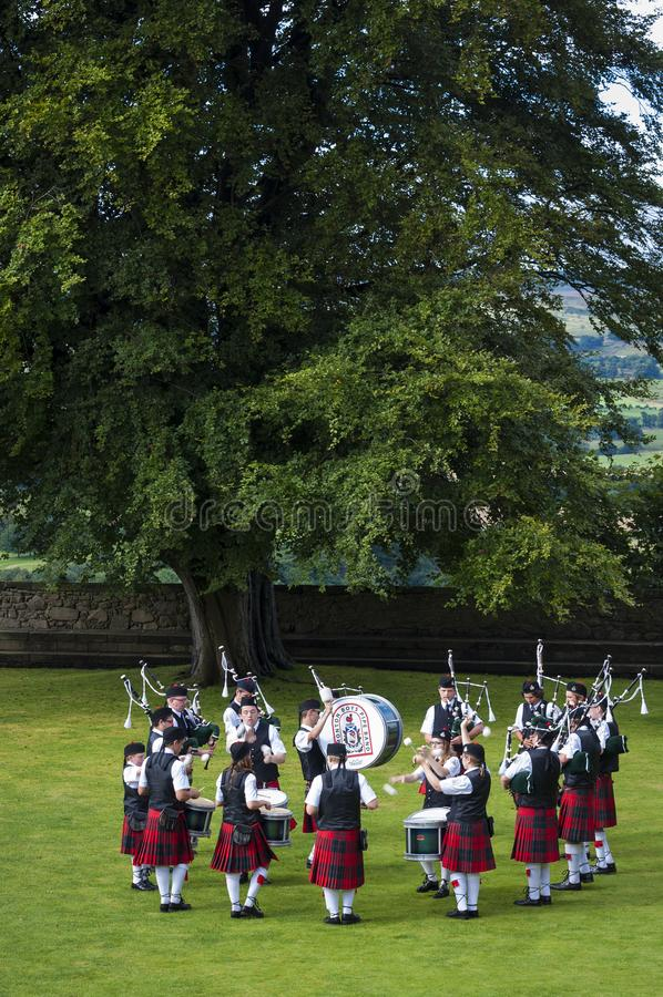 Band of pipers playing in a garde at the Stirling Castle in Stirling, Scotland, United Kingdom. Stirling, Scotland - August 17, 2010: Band of pipers playing in a stock images