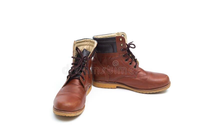 Stivale di cuoio marrone maschio, modo delle calzature isolato sulla parte posteriore bianca immagine stock libera da diritti