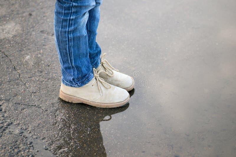 Stivali del bordo della pozza fotografia stock libera da diritti