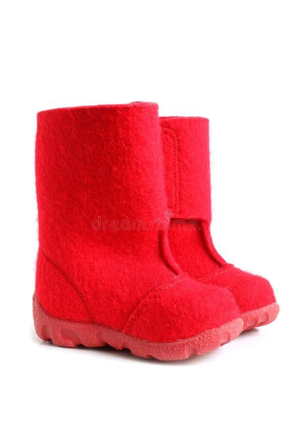 Stivali del feltro di inverno dei bambini fotografie stock libere da diritti