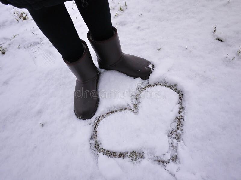 Stivali del ugg delle donne Dettagli, primo piano, tempo di inverno e stivali caldi fotografia stock libera da diritti
